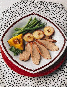 New England pork tenderloin served with green beans and baked apple slices